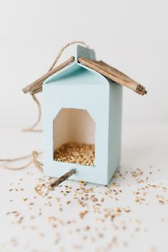 I LOVE this simple and sweet milk carton bird feeder