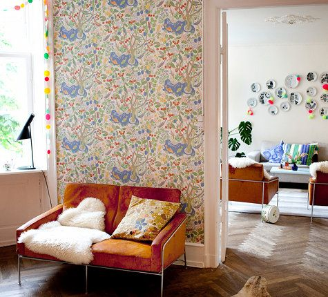 Chevron floor, a lived-in leather sofa and Josef Frank wallpaper