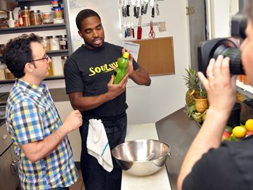 Soulvye: Photo: Bill Tremblay  Host John Catucci and Phil Dewar talk Caribbean Cuisine on the set of You Gotta Eat Here