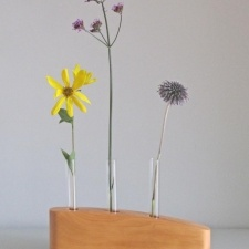 3 STEM FLOWER VASE IN YEW - A simple stylish flower stem vase hand crafted in Yew. This contemporary vase is a great way to have an exuberant display of flowers using only a few stems. I make each vase from an individual piece of wood, hand finished with natural oils to protect it and bring out the natural markings in the timber. A completely unique gift for a wedding, birthday or Christmas, or just a personal indulgence! £35.00