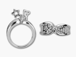 DeCoRé Charm Ring  Item #: RING-0005   In Stock  Inside Depth: 1mm Color: Silver Material: Rhodium-Plated Base Metal Finish: Rhodium-Plated This simple silver-colored band has inset detail. The two sides meet in the middle and its center is adorned with a small heart charm and star charm.