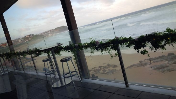 Emilie's #gorgeous #wedding at #MerewetherSurfHouse #floral #centrepieces #tallvases #mirror #tealights #stunning #bridaltablebackdrop #fairylights #balconyFlowers