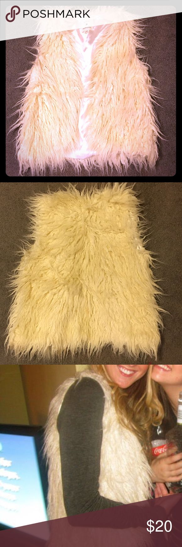 Faux fur vest Off-white, satin lined, 70's style shaggy faux fur vest. Looks adorable over a long sleeve t shirt and jeans Forever 21 Jackets & Coats Vests