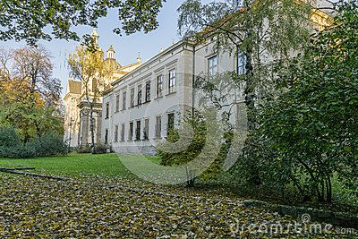 Old buildingin the centre of the Krakow city in the park name Planty. Autumn in the evening time.