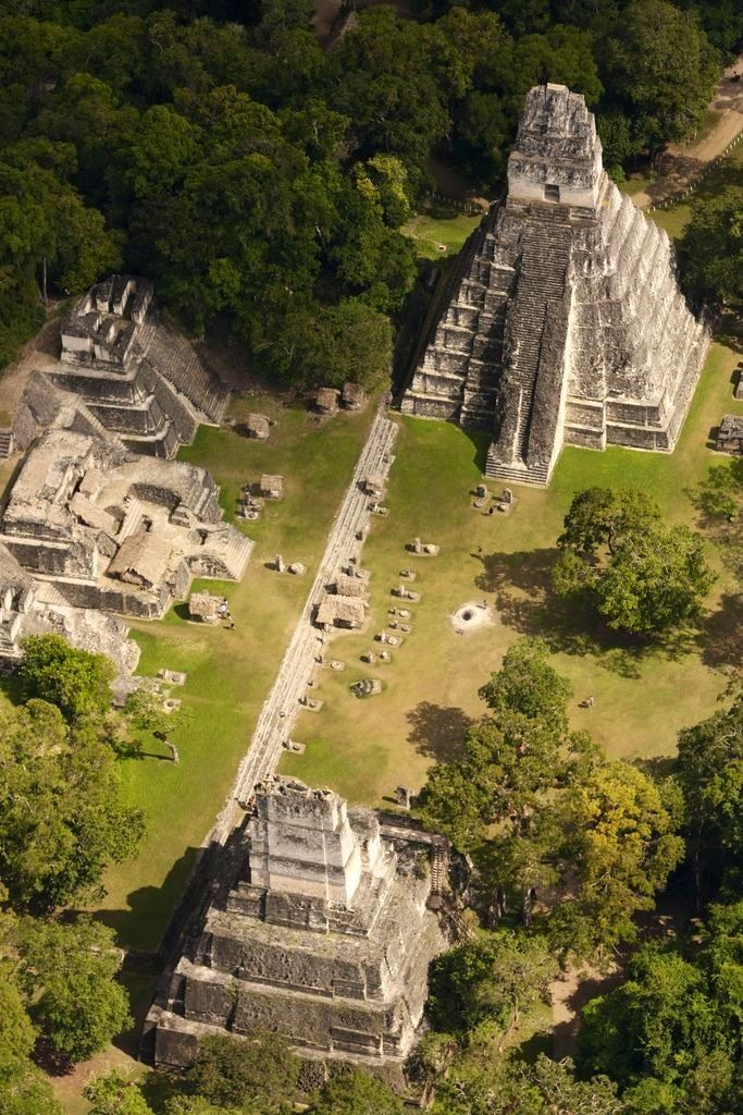-honestly, how did people who never had contact with each other build the same types of structures?...pyramids...Tikal , Guatemala.