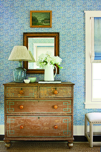 Phoebe Howard - LOVE the old painted chest, the fresh new wallpaper, contemporary bench near by.