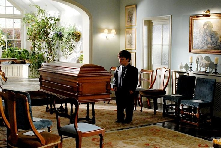 Peter (Peter Dinklage) pays his respects to his friend, in the 2007 British comity film, Death at a Funeral