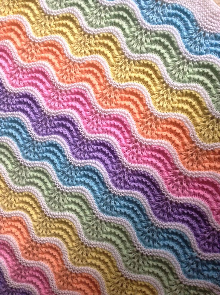 Free Knitting Pattern for Pastel Rainbow Baby Blanket - An easy baby blanket with feather and fan stripes. Designed by Stitchylinda Designs