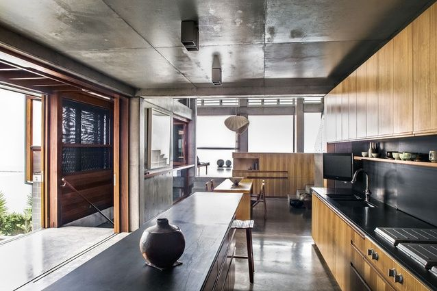 South Coast House NSW. A modern aesthetic is reinforced by the pale blackbutt timber joinery in the ground-floor kitchen.
