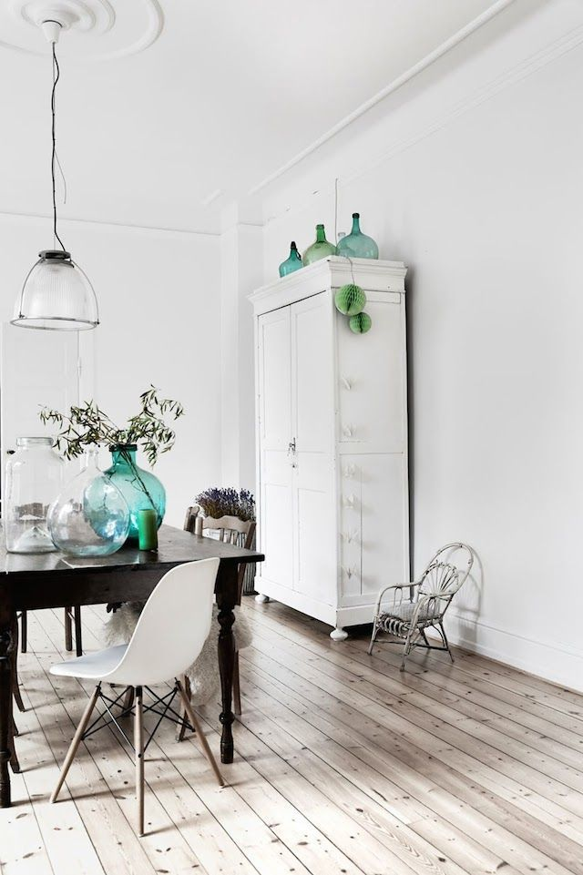 ...Really love the mint and green glass bottles plus the green paper balls in the back #decor #interiordesign #glassbottles