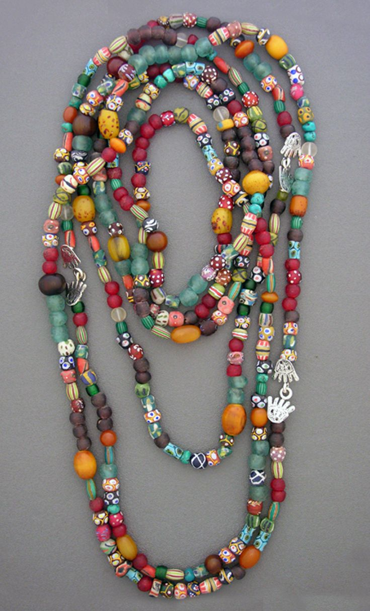 "by Anna Holland | ""Riot of Colour"". Wide assortment of beads; Crow's eye polka dot and flowered antique whitehearts; Venetian multi-color melon beads and round and biconal powder beads, both plain and patterned; recycled powder glass beads from Ghana; and faux amber and horn beads from Ethiopia. These beads span several hundred years in the making"