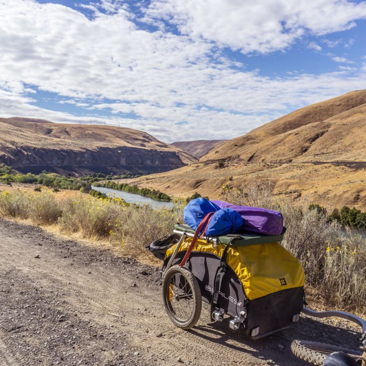 Nomad bike cargo trailers are designed specifically for touring. The Nomad encourages comfortable wanderlust with its large carrying capacity and weatherproof cover.