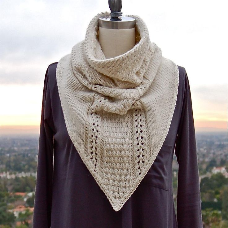 A stylish combination of a cowl combined with a kerchief in a textured stitch pattern that looks much more complex than it really is. This scarf is knitted flat from the top down and fastens in the back with buttons and crocheted button loops. The top edge is self-faced for extra body, and the edges have a slip-stitch garter selvedge so the kerchief will lie nice and flat.The sample was knit in Shibui Knits Merino Alpaca. A substitute yarn is shown below.