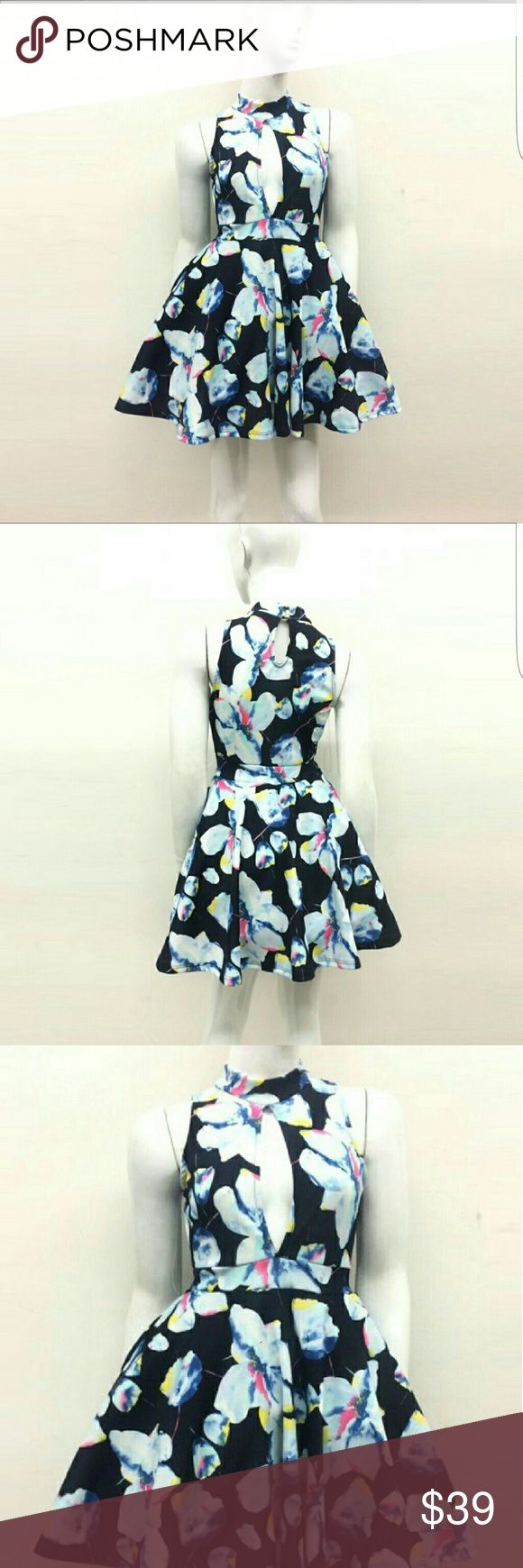 Navy floral high neck cut out skater dress Gorgeous navy skater dress with floral design, high neck and cutouts at bust line. Perfect for spring/summer events or just a nice dinner. Dresses