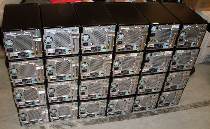 A small wall of Shuttle PCs prepared for rental to a training course company. 1512 MIPs of processing power to run Powerpoint presentations!