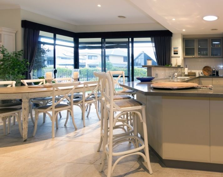 White cross back stools and dining chairs