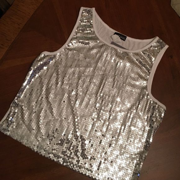 ❗️FINAL PRICE❗️WET SEAL Sequin Tank Top Silver sequin tank top super cute with a skirt or jeansBrand new never worn tags still attached Size XL Looks to me like more of a regular large Wet Seal Tops Tank Tops