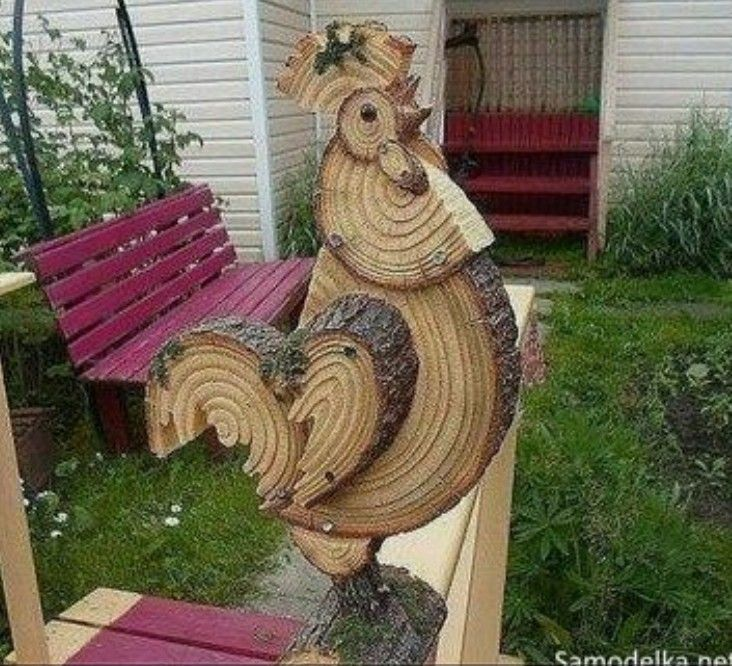 Rooster made from tree limb slices