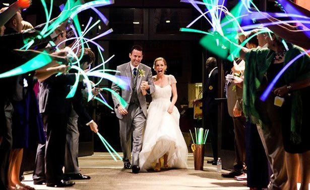 As the bride & groom make their way down the walkway, their guests greet them with GLOW. How fun & unique! This here's my favorite FBL product for wedding fun like this - fiber optic white sparkles *Ooo* la la: http://www.flashingblinkylights.com/new-white-flashing-stick-wands-with-white-sparkle-fibers-sku-no-11777-wt.html