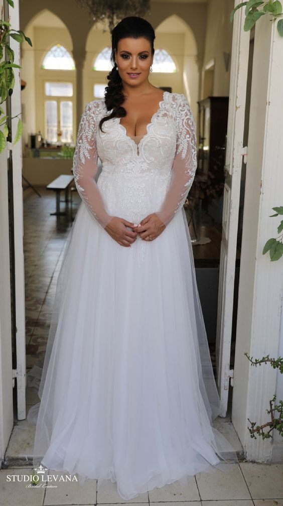 Stunning princess plus size wedding gown with long lace sleeves and tulle skirt. Tracie. Studio Levana