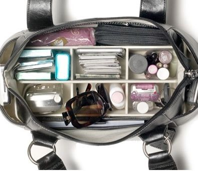 As much as I try to keep my work bag and purses organized, I find that I'm always digging around in a giant black hole searching for my cell phone, keys, iPod, lip gloss and wallet. When I first saw this Butler Bag on Popgadget, I knew that this was a