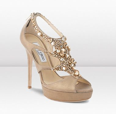 These sumptous evening sandals are lavishly embellished with Swarovski crystals in soft gold tones.    $1925