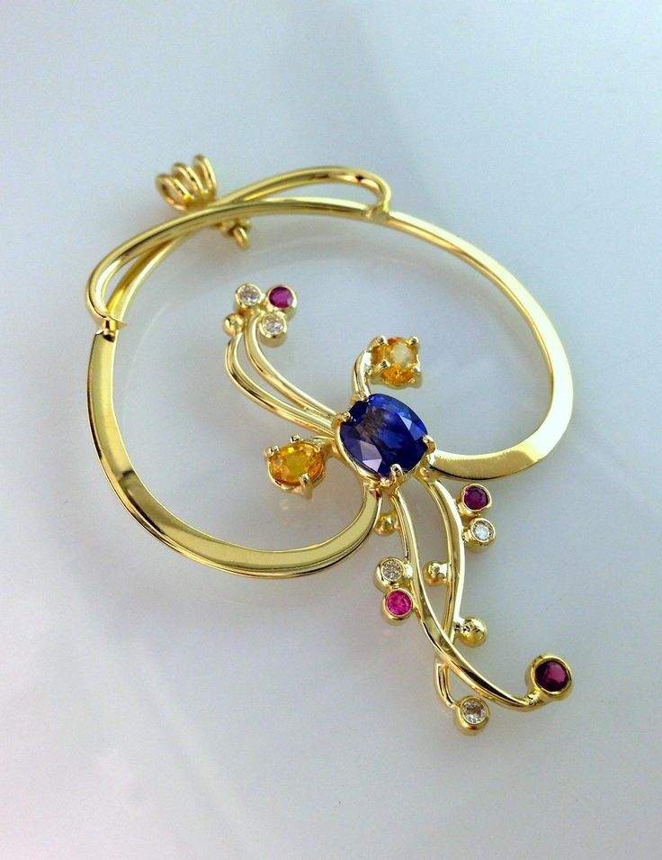 Hand forged 18k yellow gold, Sapphires and diamonds pendant. www.kenweston.com