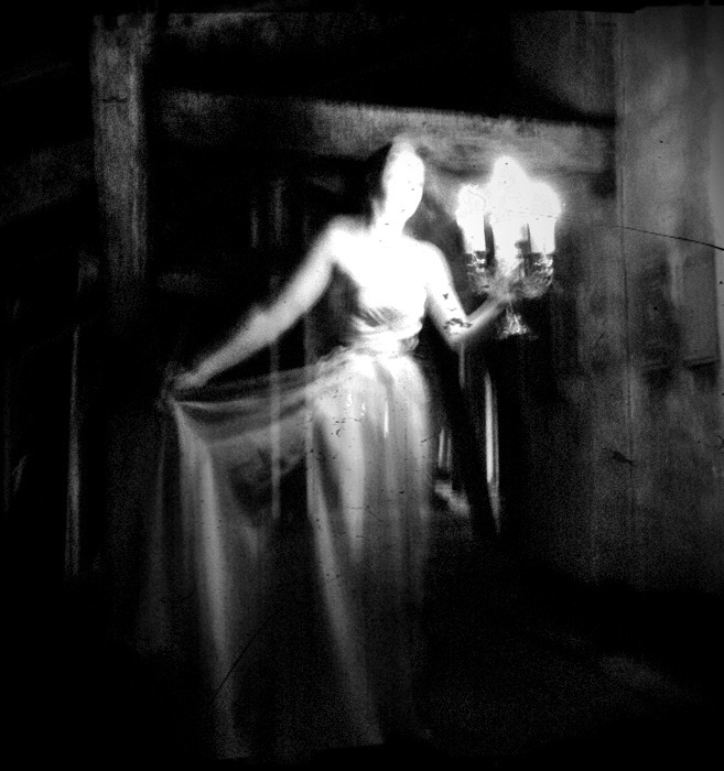 """""""Ghost"""" lady with candelabra"""