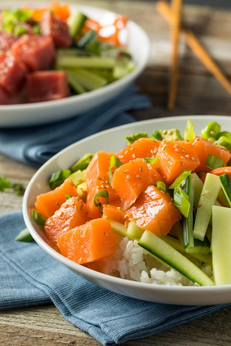 Raw Organic Salmon Poke Bowl with Rice and Veggies