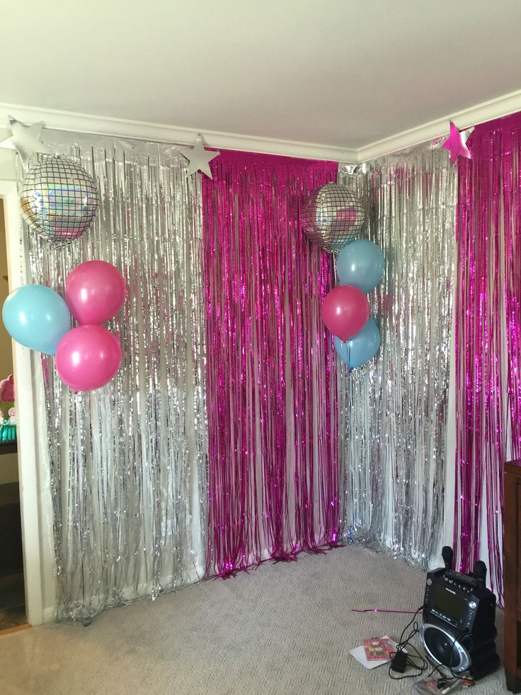 Karaoke stage / photo area  Not pink maybe sliver and gold mixed or pastel colours