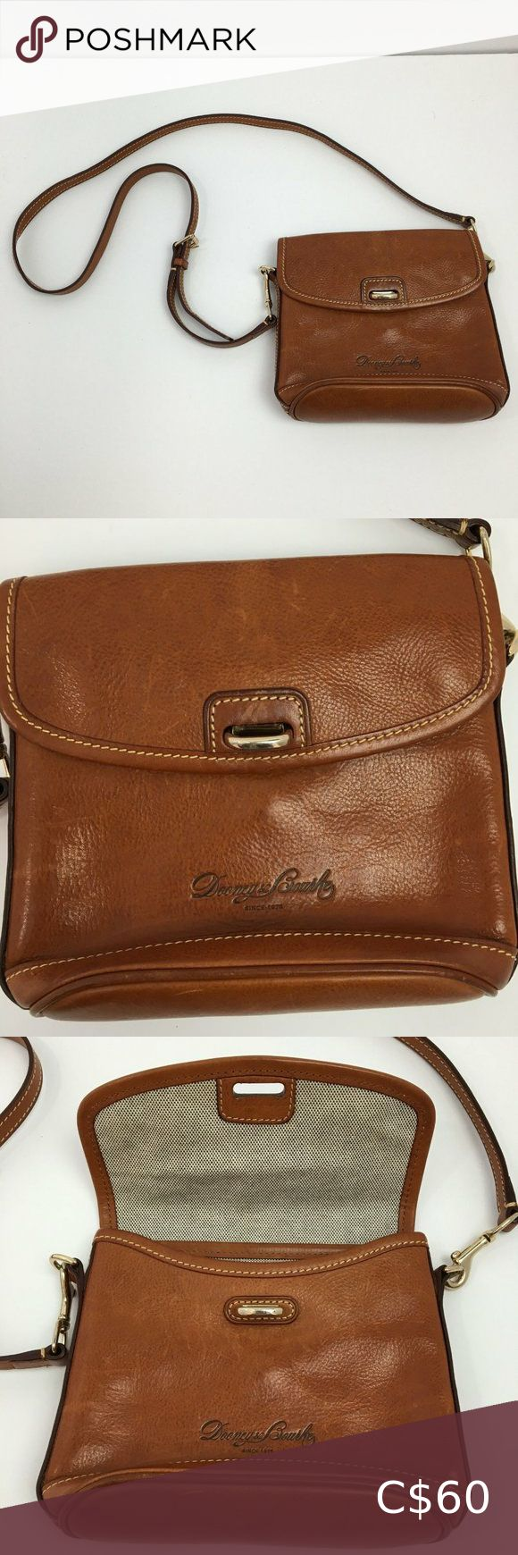 Dooney & Bourke Leather Crossbody Sling Bag Women's Dooney & Bourke 1975 Genuine Leather Crossbody Sling Purse Tote Bag. Features a detachable strap, and 2 inner compartments/pockets! Color Brown. Nice condition. Strap missing on back, appears to have been cut. See photos for full details.  Measurements:  Overall Length: 7.5