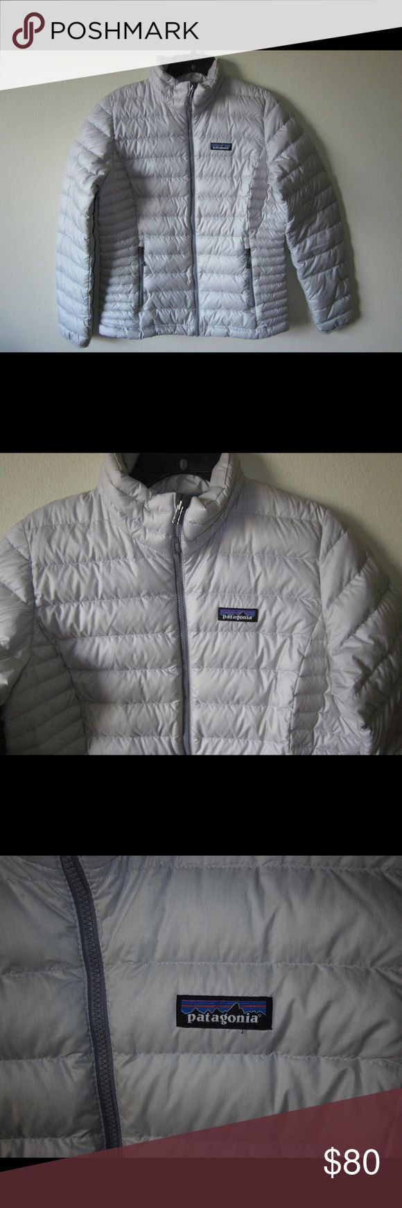 Patagonia Down Sweater Jacket M Very good condition with just some light staining on the cuffs and a small spot on the front where the material got snagged. Rolls up into the chest zipper pocket into a cute little pouch that you can easily store! Patagonia Jackets & Coats Puffers