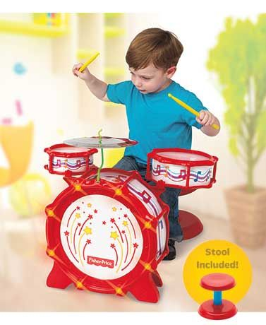 """With this Fisher-Price Big Bang Lighted Drum Set, kids can put on their own show. With big sound and flashing lights, the set encourages young drummers to explore, create and perform musical rhythms. On/off switch. Requires 3 """"AA"""" batteries. Plastic and"""