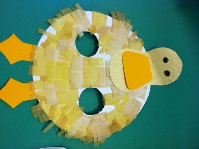 D is for Duck! An easy paper plate craft for preschoolers. Cut two children-sized arm holes in a paper plate (for duck wings). Children can decorate the body of the duck using tissue paper or crepe paper, and add head and feet for the duck! #Greenwich Library #Children's #Crafts