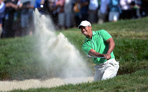 Tiger Woods- I wish I could hit amazing shot from the sand trap like him.
