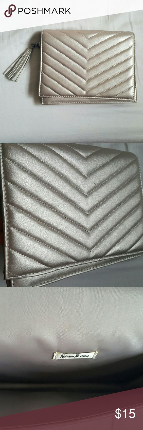Clutch Cute silver clutch perfect for your night outs. Dress this up or dress it down. Neiman Marcus Bags Clutches & Wristlets