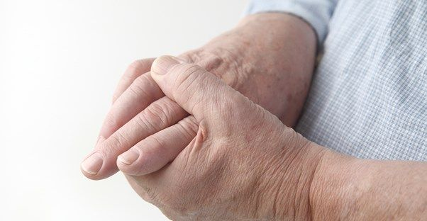 Early rheumatoid arthritis symptoms affect the smaller joints in the wrists, hands, and feet, and in most cases the same joints on both sides of the body. The most prominent symptom is joint inflammation.