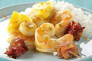 These smoky shrimp and bacon kabobs get their sweet and sour flavor from pineapples and a ready-made sauce—plus a surprising crunch from water chestnuts.