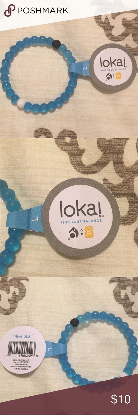 NWT Lokai bracelet Blue size Large Lokai bracelet. White bead holds water from mount everest and the black bead holds mud from the dead sea. Highest/lowest points on earth Lokai Jewelry Bracelets
