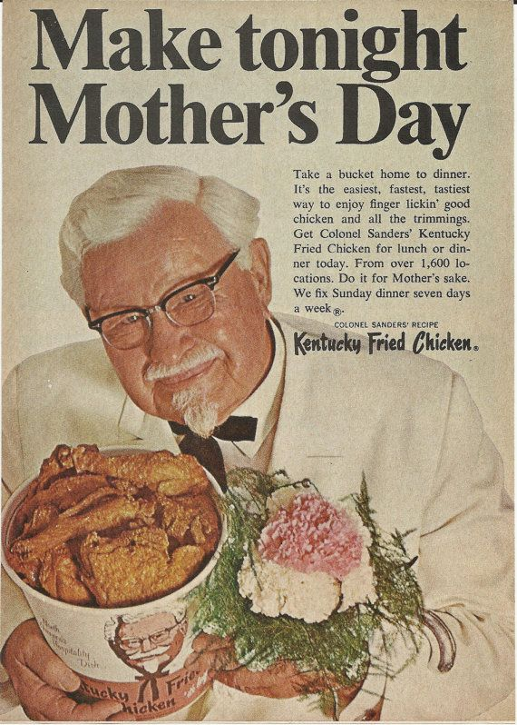 Colonel Sanders with a bucket of chicken and carnations for his mom