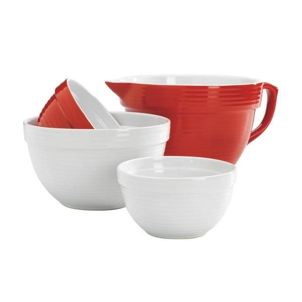Get all your baking tasks accomplished with this cute red and white Anchor Hocking Mixing Bowl Set. Featuring a Red Batter Bowl and three mixing bowls you can easily make pancakes, cakes, icing, cookies and more all at once so that you can get a head of the holiday season without a sweat! These charming red and white coloured set of bowls stack inside each other and make a wonderful gift for any home bake and aspiring chef this holiday season!