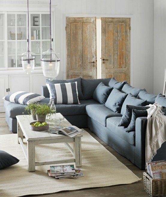 Gray Couch And Striped Pillows
