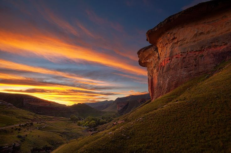 SANDSTONE FORTRESS Golden Gate National Park, Free State, South Africa The skies of the Free State light up in flaming sunset colours over tthe Van Reenen campsite in Golden Gate Highlands National Park....