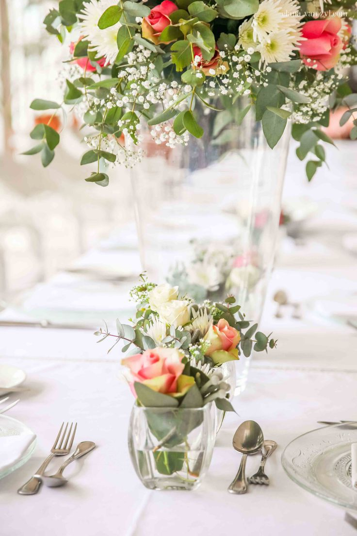 Soft pinks, creams and leafy greens lined the long table set for Ounooi and Jacques' intimate wedding