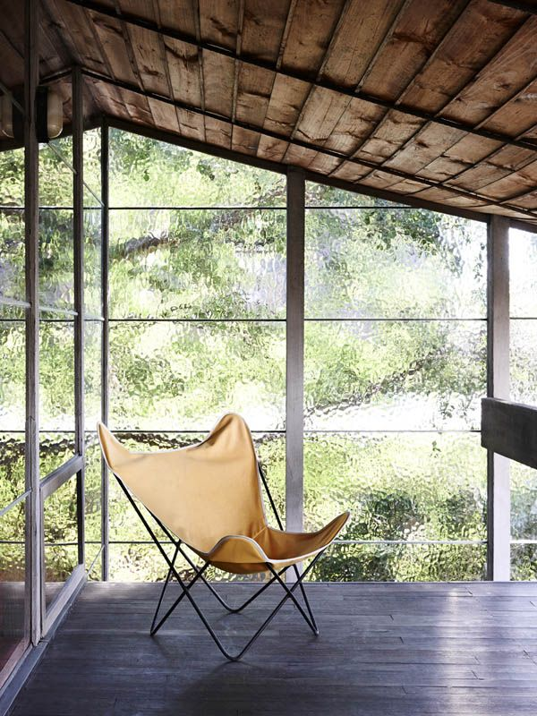 Upstairs balcony adjoining Robin and Patricia's bedroom. Butterfly chair (find similar at Angelucci Twentieth Centuryin Melbourne).  Phot...
