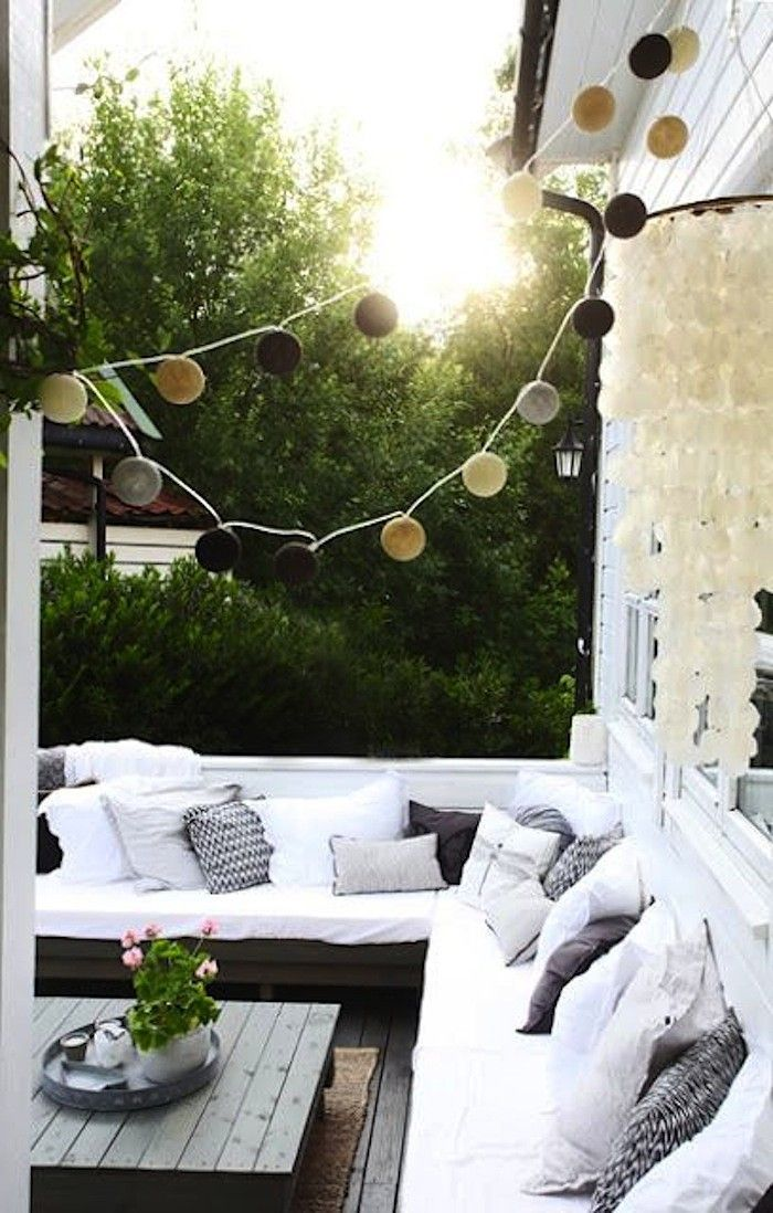 10 Favorite built-in sofas for decks and patios. Patio Sofa with White Cushions and String Lights I Gardenista
