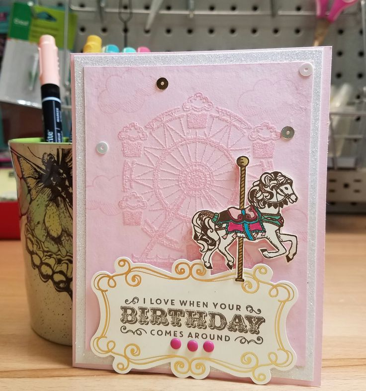 Birthday card made with Stampin Up's Carousel Birthday. Card stock and ink for background is Pink Pirouette. The carousel is embossed with heat and stick and glitter is added.