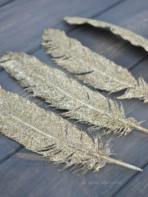We use DIY glittered feathers as art for the living room but you can literally put them anywhere to shine up a space!