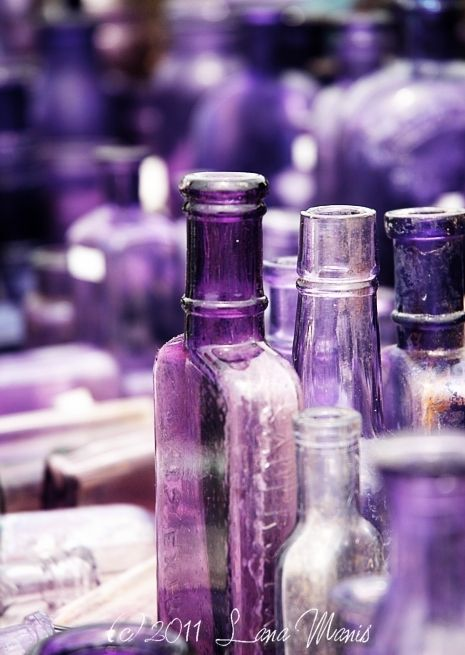 Antique glass bottles in shades of purple