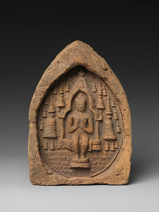 Votive Plaque: Seated Buddha in a Temple, ca. 9th–10th century. The Metropolitan Museum of Art, New York. Gift of The Kronos Collections, 1982 (1982.462.6) | Molded images were produced at the great pilgrimage sites and had relic status for devotees. Here, the Buddha sits within a temple that looks very much like the Mahabodhi temple at Bodhgaya. #Buddhism